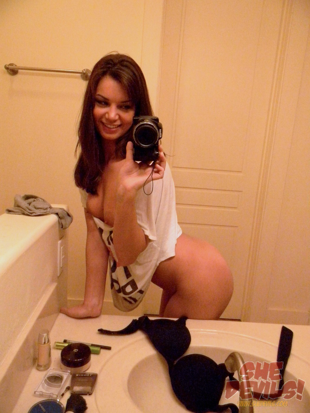 Teen brunette mirror