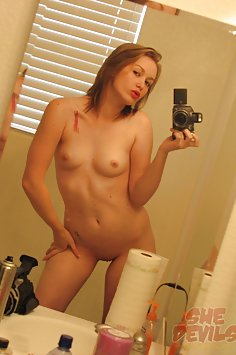 Flirty girl friend gets naked in some mirror shot pictures